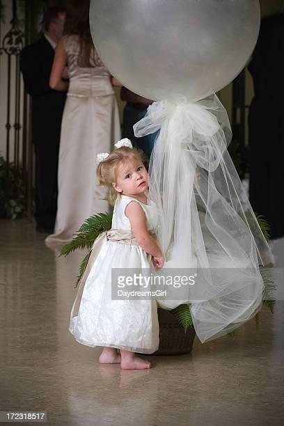Cute Barefoot Child Wearing White Dress Holding Balloon Decoration