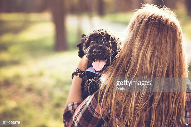 Cute black dog with his owner