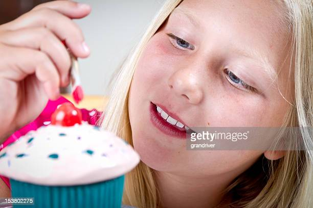 Cute Blond Ten Year Old Girl Painting Pottery
