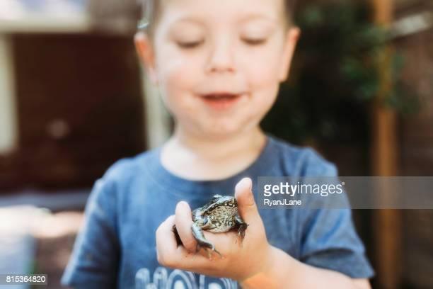 Cute Boy Holding Frog