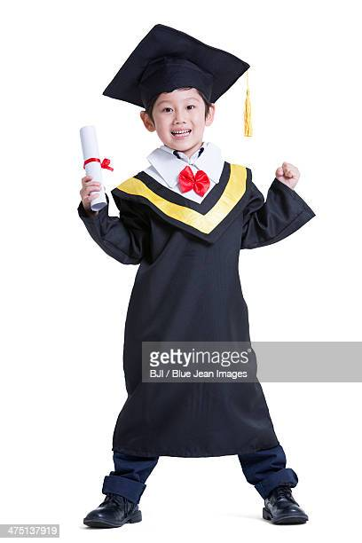 Cute boy in graduation gown
