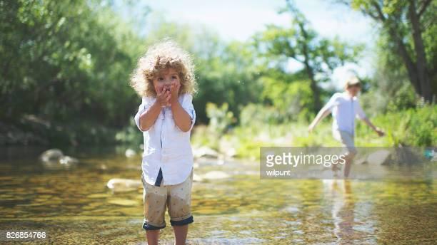 Cute boy in water