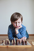 Cute boy playing chess