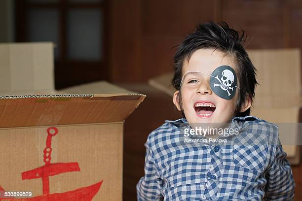 Cute boy playing pirates, happy and smiling