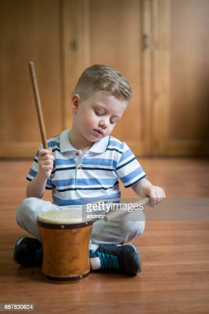 Cute boy playing the drum