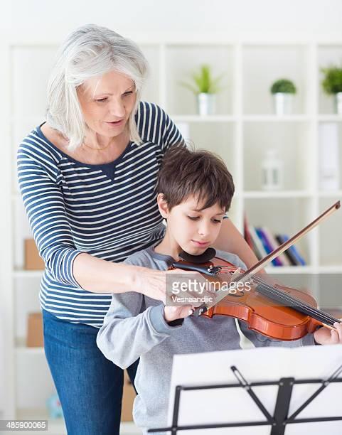 Cute boy practicing playing violin