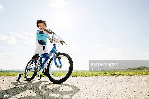 Cute boy riding a bike.