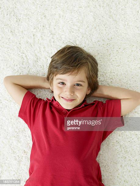 cute boy smiling on the carpet