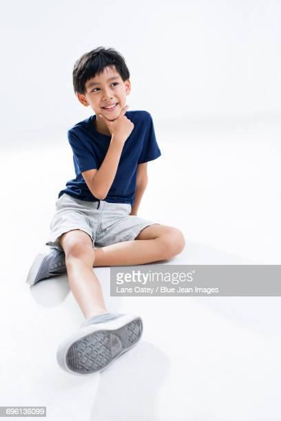 Cute boy thinking
