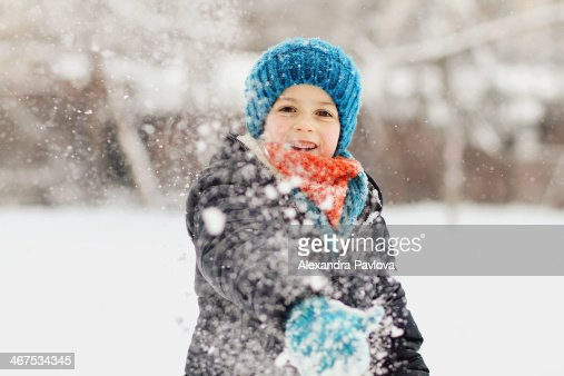 Cute boy throwing a snowball