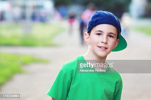 cute boy wearing baseball cap backwards