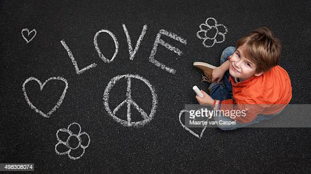 Cute Boy, with Chalk on Street/Tarmac, Love Peace Flowers Happin