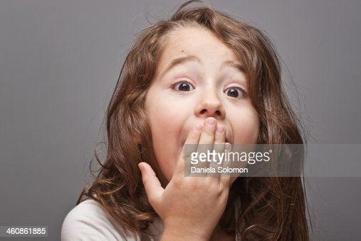 Cute boy with long hair, surprised : Stock Photo