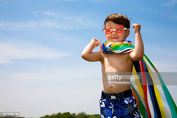Cute Boy With Swimwear On Flexing Muscles