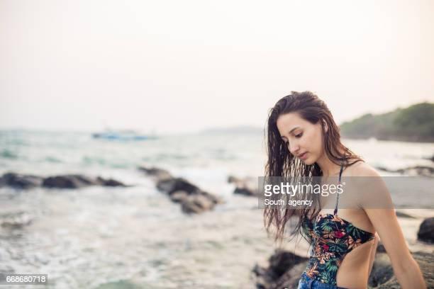 Cute brunette by the sea