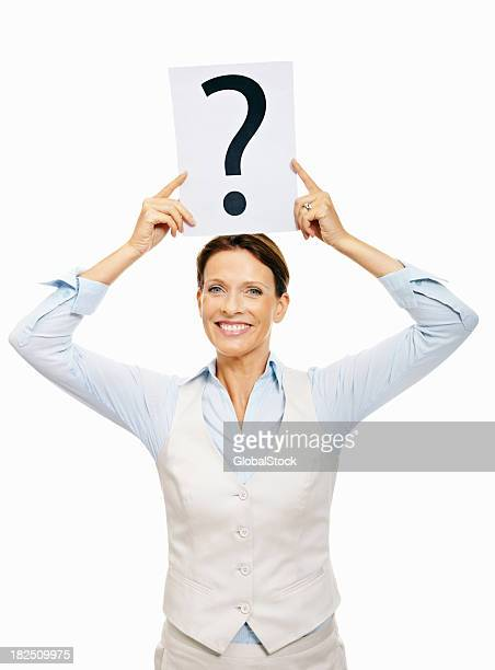 Cute Business woman holding a question mark sign on white