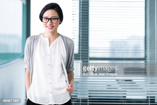 Cute businesswoman with glasses in the office