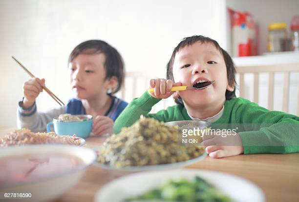 Cute child enjoying lunc