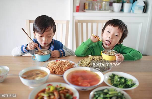 Cute child enjoying lunch