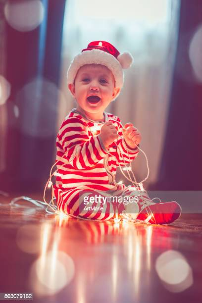 Cute child in pajamas indoors in Christmas