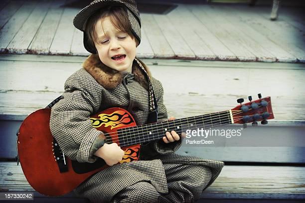 Cute Child Playing Guitar and Singing- Rockabilly Boy