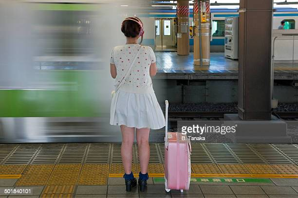 Cute Commuter and Yamanote Train in Tokyo, Japan