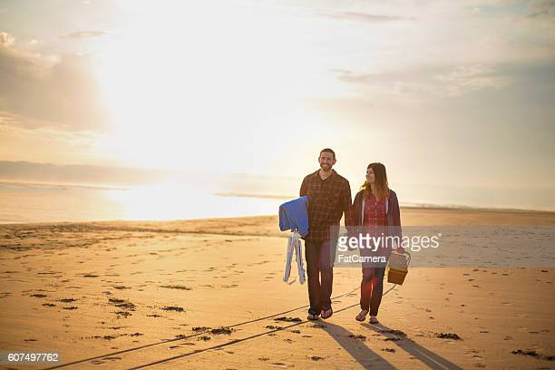 Cute couple holding hands and walking on the beach