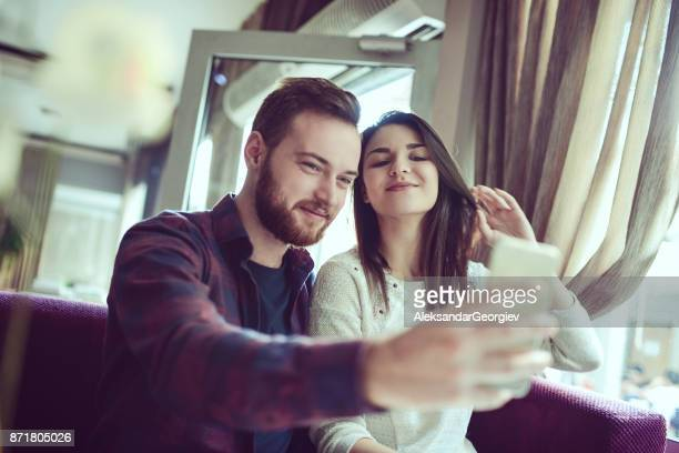 Cute Couple Taking Selfie in The Morning at Home