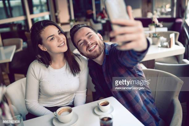 Cute Couple Taking Selfie in The Morning
