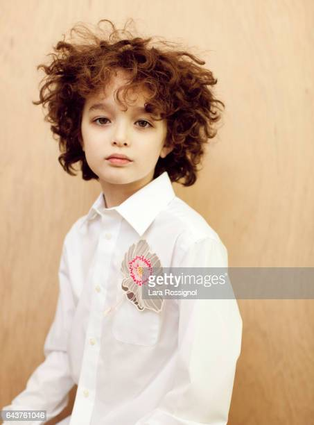 Cute Curly Haired Boy in White and Flower