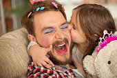 Cute daughter and her father having princess time.