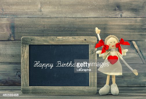 Cute doll with Red Heart. Lovely Birthday decoration. Holidays card : Stock Photo