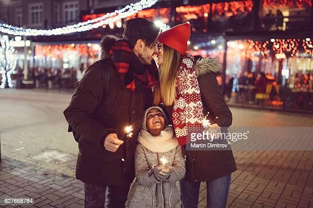 Cute family wishing Happy New Year