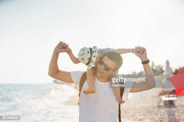 Cute father and son on the beach