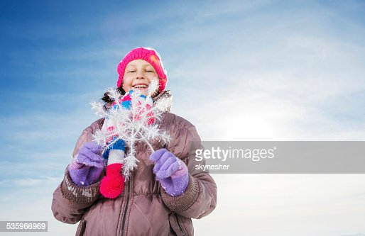 Cute girl against the sky during winter season. : Stock Photo