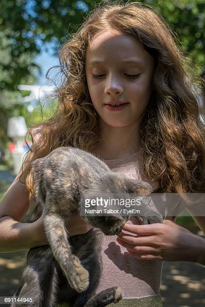 Cute Girl Carrying Cat