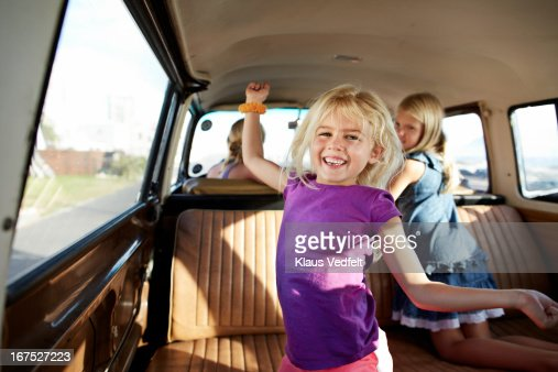 Cute girl dancing in back of old camper van : Stock Photo