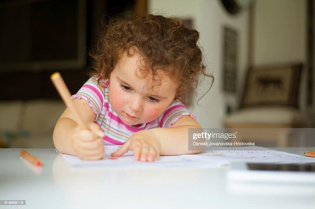 cute girl drawing : Stock Photo