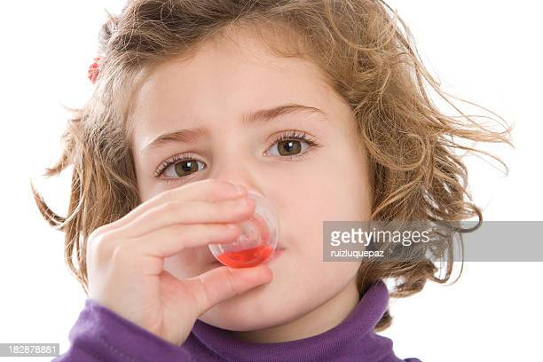 Cute girl drinking her medicine