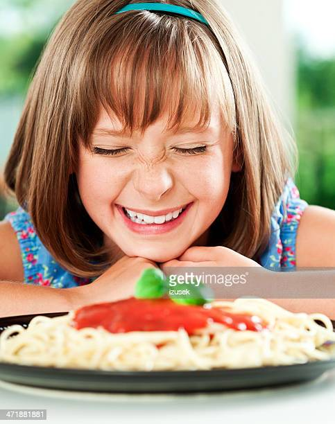 Cute girl eating spagetti