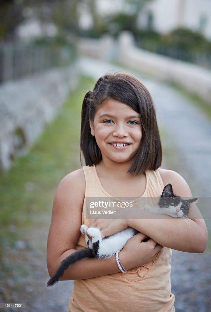 Cute girl holding kitten : Stock Photo