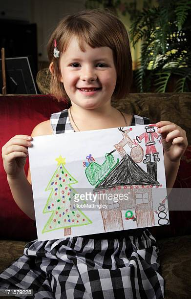 Cute Girl Holds Drawing