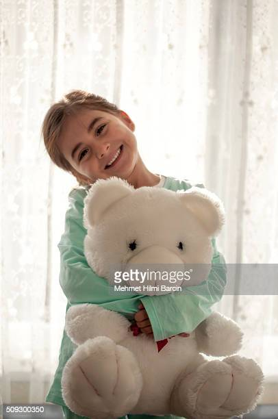 Cute girl hugging each other her teddy