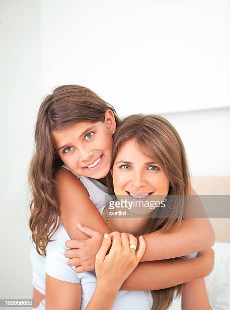 Cute girl hugging her mother.