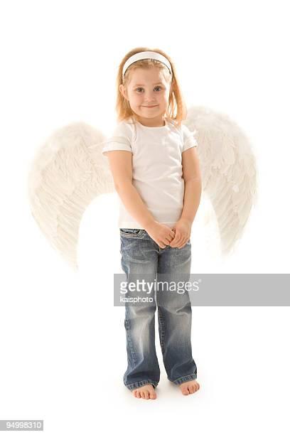 A cute girl in a little angel costume