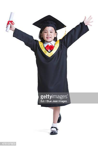 Cute girl in graduation gown