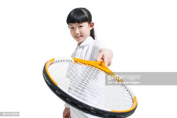 Cute girl playing tennis