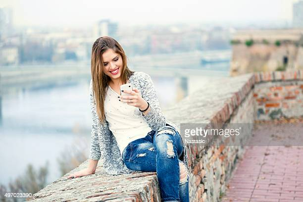 Cute girl reading message