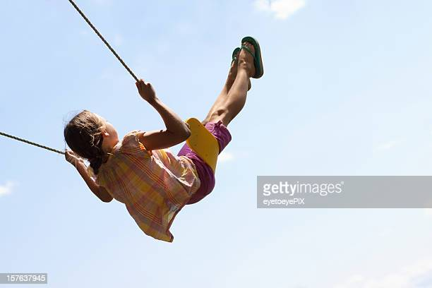 Cute Girl Swinging High in Air 2