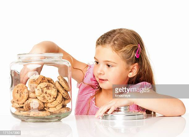 Cute Girl Taking Out Chocolate Chip Cookie - Isolated